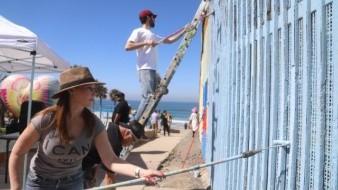 Artistas dan color  a muro de Playas; buscan Guinness