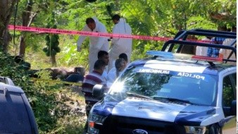 Hallan 19 cuerpos en fosas clandestinas en Colima