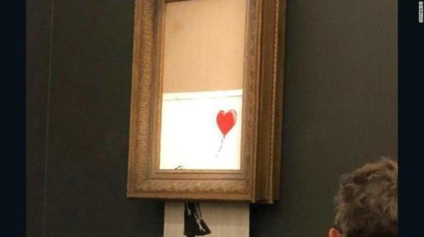 VIDEO: Se autodestruye obra de Banksy tras ser subastada en más de un millón de dólares