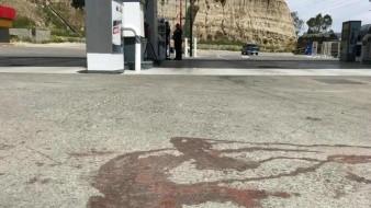 Con presuntos cadáveres de sus padres detienen a joven en gasolinera de Tijuana