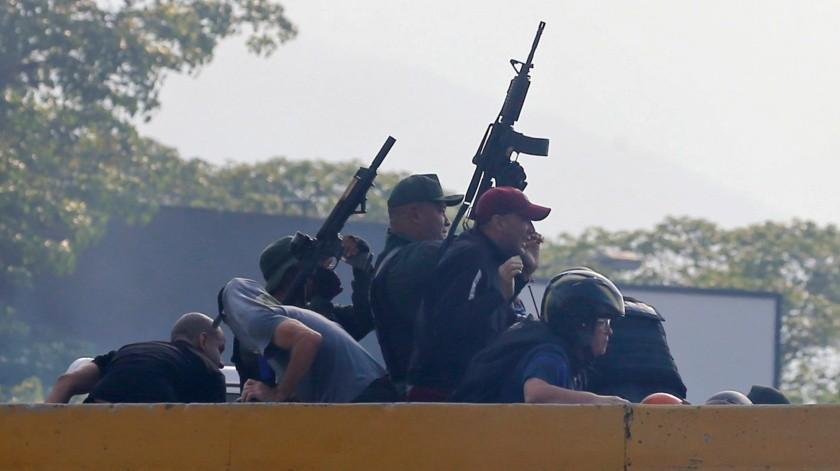 """El canciller colombiano Carlos Holmes Trujillo leyó un comunicado del grupo en el que llamó a las fuerzas armadas venezolanas a que manifiesten """"su lealtad al Presidente encargado Juan Guaidó"""".(AP)"""