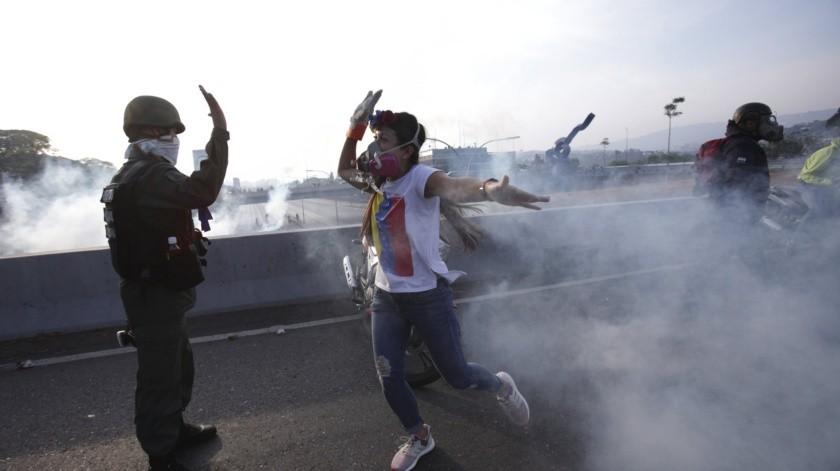 Manifestantes venezolanos.(AP)