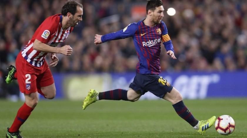 Digo Godín y Lionel Messi(AP)