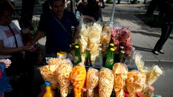 A street vendor sells fried food in Mexico City, Tuesday July 5 2016. A study published Tuesday, July 5, 2016, shows that Mexico