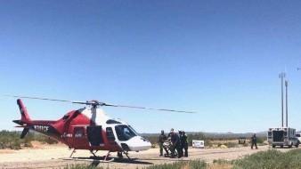 A bordo de helicóptero salvan vida de migrante