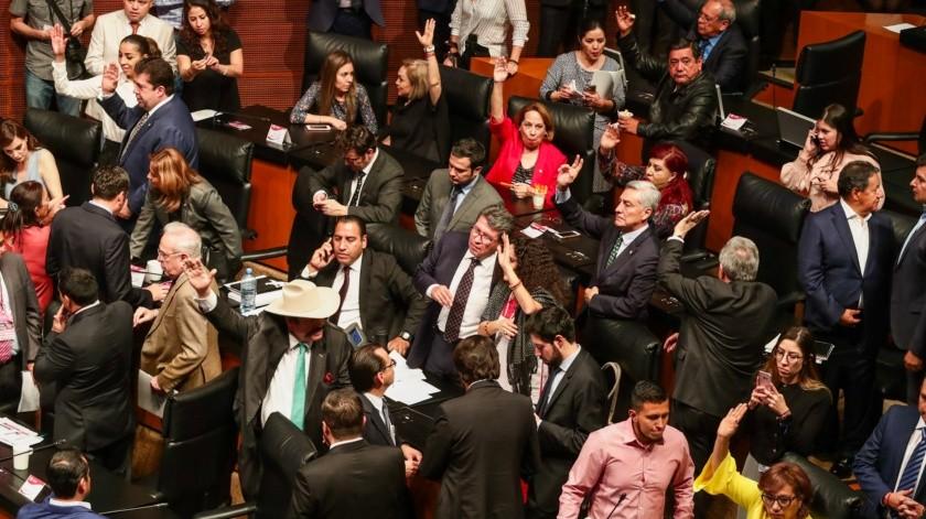 Aspectos de la votación y aprobación del proyecto de decreto que expide las cuatro leyes secundarias de la Guardia Nacional, durante la sesión extraordinaria que tuvo lugar en el Senado de la República(El Universal)
