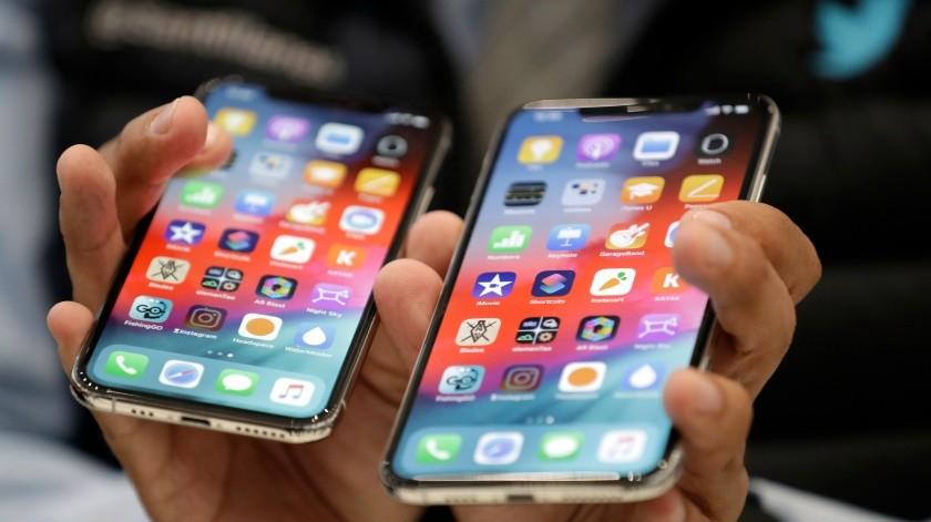 Apple no se quedará de brazos cruzados mientras los gobiernos de Estados Unidos y China se lanzan amenazas e intimidaciones.(AP)