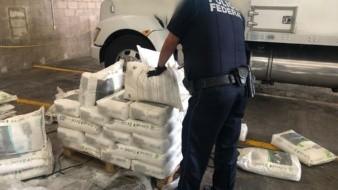 Los sacos se encontraban sobre una tarima que tenía como destino un domicilio en Ensenada, Baja California.