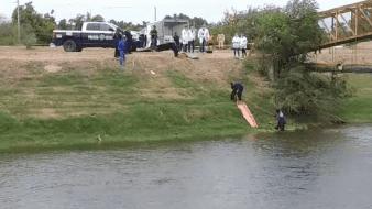 El cuerpo del hoy occiso, aún sin identificar, luego del ataque terminó en el interior de las aguas del canal.