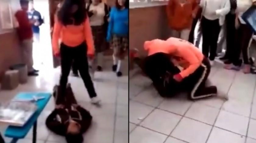 Captan a joven golpeando a compañera en salón de clases; director se burla(Captura de pantalla)