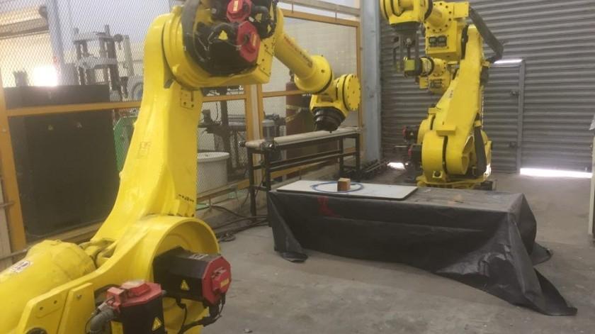 Ford Motor Company donó a la institución un robot tipo Fanuc.(Leonor Hernández)