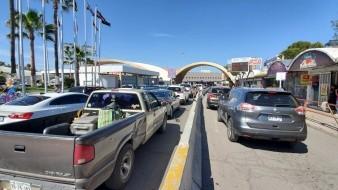 A horas de restringir acceso a frontera de México- EU, aumentan filas para cruzar garitas