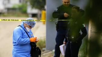 La víctima vestía una camisa blanca a rayas negras y un pantalón azul, tenía cabello corto.