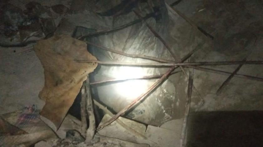 El cadáver fue localizado al interior de una fosa de aproximadamente dos metros de profundidad.(Cortesía)