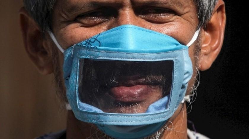 Crean en Indonesia cubrebocas transparentes para sordomudos(EFE)