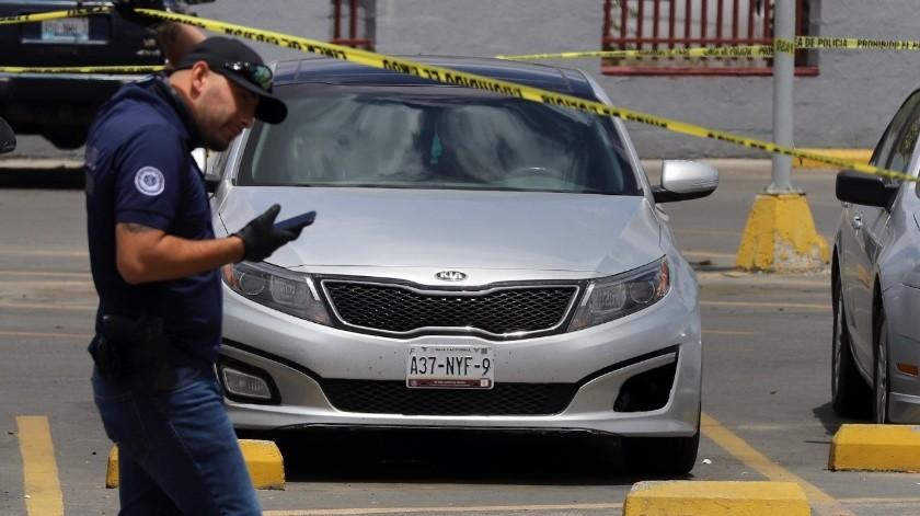 El vehículo donde estaba la víctima estaba en el estacionamiento de las oficinas.