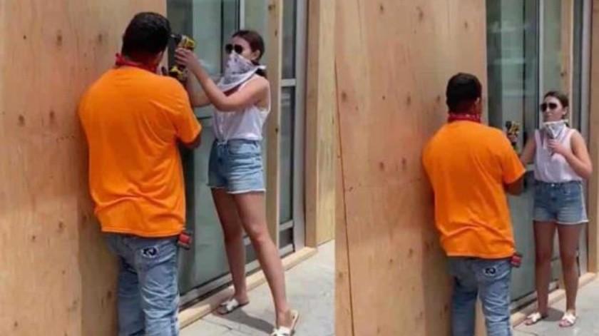 Finge ayudar a un hombre mientras le toman una foto(Tomada de la red)