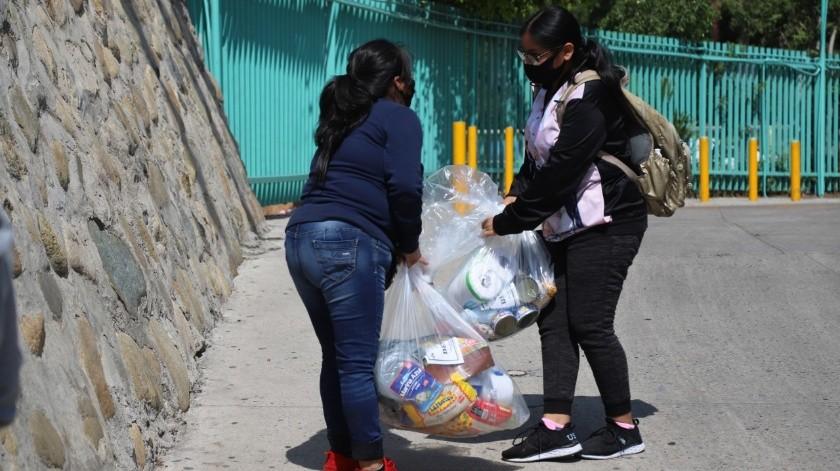 Con la entrega de despensas se beneficiará a aproximadamente mil familias.Con la entrega de despensas se beneficiará a aproximadamente mil familias.(Sergio Ortiz)