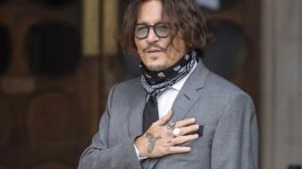 El actor Johnny Depp llega a la Corte Suprema para una audiencia en su caso de difamación contra un tabloide británico, en Londres.