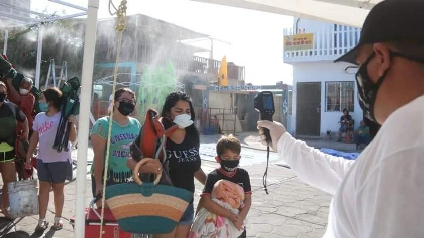 En Puerto Peñasco se instalaron filtros en la entrada de las playas donde se tomaba la temperatura a los visitantes.(SUSANA ARANA)