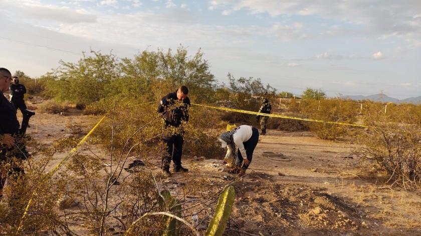 Con la quema de una llanta intentaron los homicidas desaparecer en su totalidad los restos óseos.(Especial)