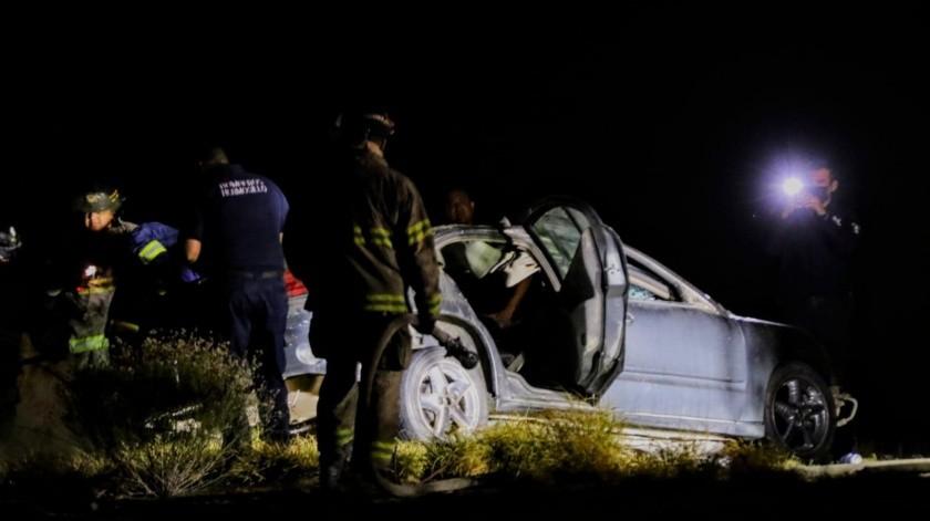 Dentro de un carro Pontiac GranAm, color gris, modelo 2003, quedaron los cuerpos sin vida(GH)