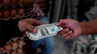 Peso mexicano se aprecia y cotiza en 21.10 por dólar ajeno a repunte de Covid-19