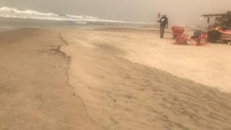 Cubre capa de humo y cenizas zona Centro de Rosarito