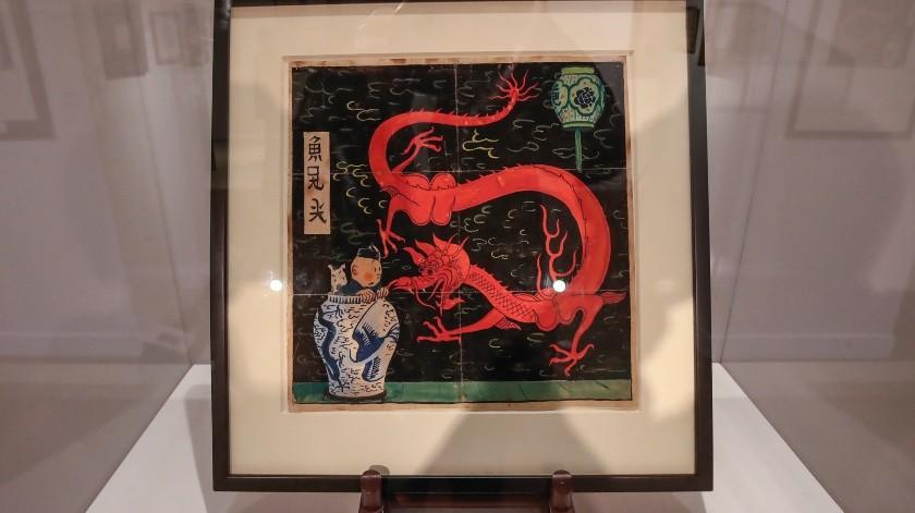 """Un dibujo original de 1936 del creador de Tintín, Herge, para el libro de historietas """"The Blue Lotus"""", se exhibe en la casa de subastas Artcurial en París.(AP)"""